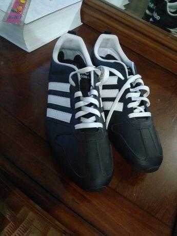 Продам новые кожаные кроссовки