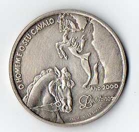 """Moeda de prata de 1000$ """"o homem e o seu cavalo"""" de 2000"""