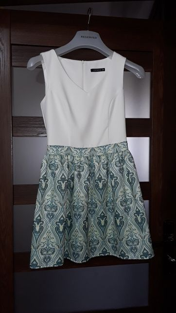 Sukienka zielono kremowa jak nowa.