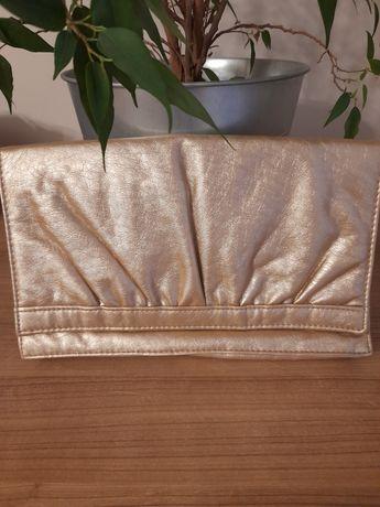 Złota kopertówka do ręki
