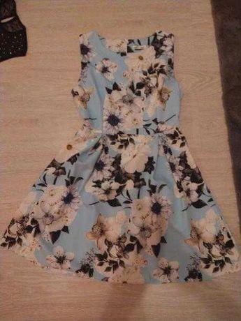 Sukienka w kwiaty rozmiar M /L