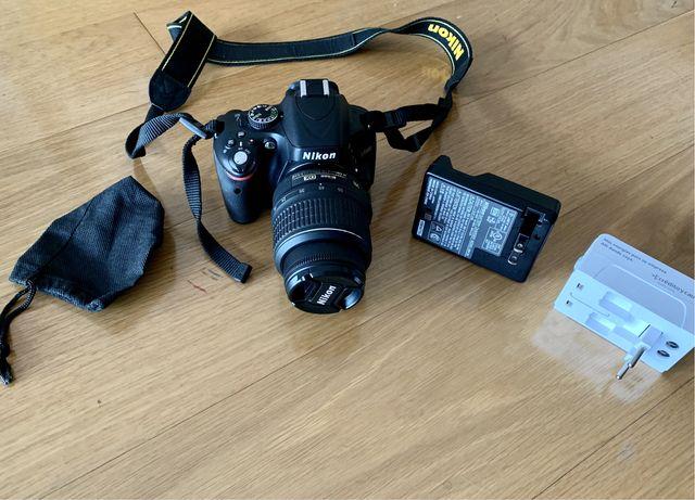 Nikon D5100 com lente