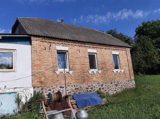 Дом с. Хотов на тихой улице с участком земли 12 сот