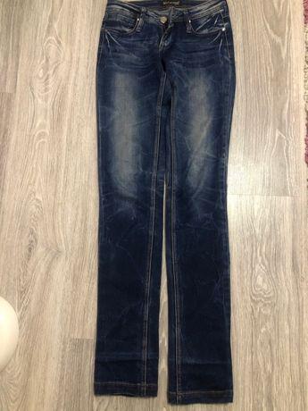 Продам джинси темного кольору