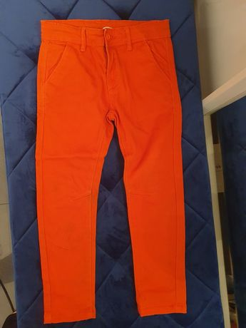 Pomarańczowe spodnie Cool Club by Smyk
