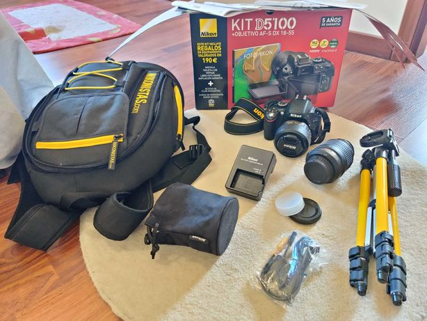 Nikon D5100 + Lente DX AF-S 18-55mm + Lente DX AF-S 35mm + acessórios