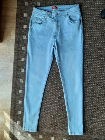 Spodnie Rozm M z zameczkami