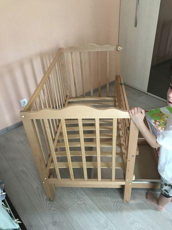 Дитяче ліжко гойдалка