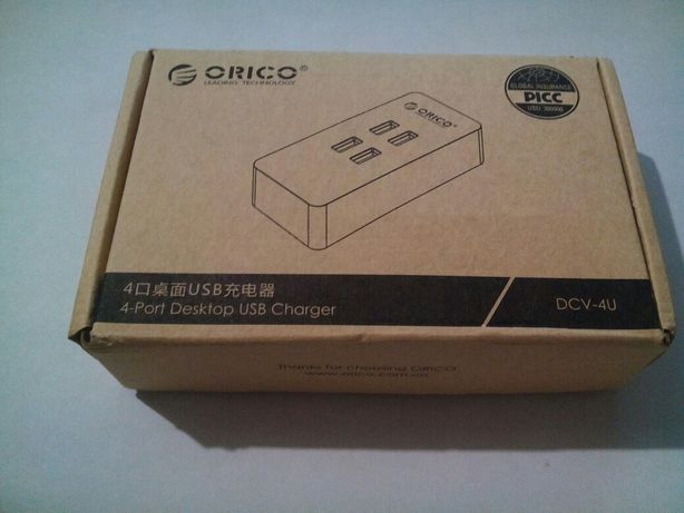 Orico брендовая зарядка 4 порта 5В до 2.4А каждый, макс 20Вт