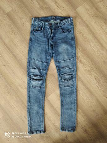 męskie jeansowe slimowane spodnie Cropp rozmiar L