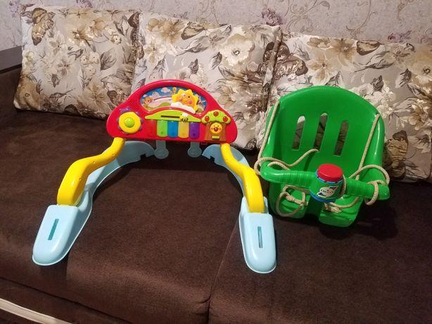 Музыкальная игрушка и качеля