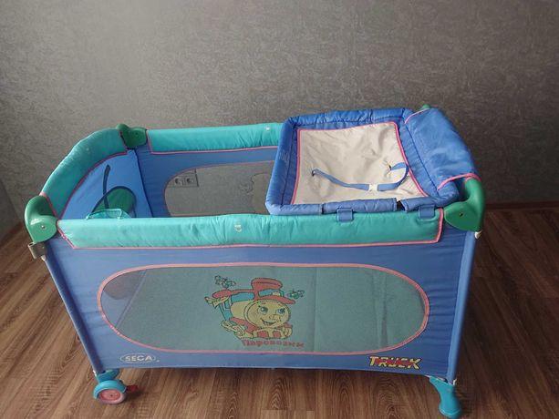 Продам манеж-кроватка-пеленатор-игровой домик паравозик Seca