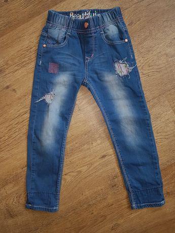 Spodnie jeansowe przetarcia 104