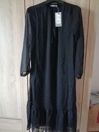 Sukienka śliczna do pół łydki 44
