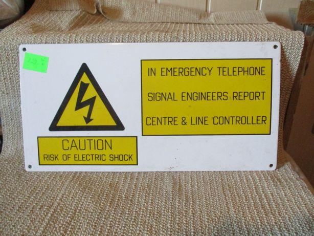 Tabliczka emaliowana ryzyko porażenia prądem