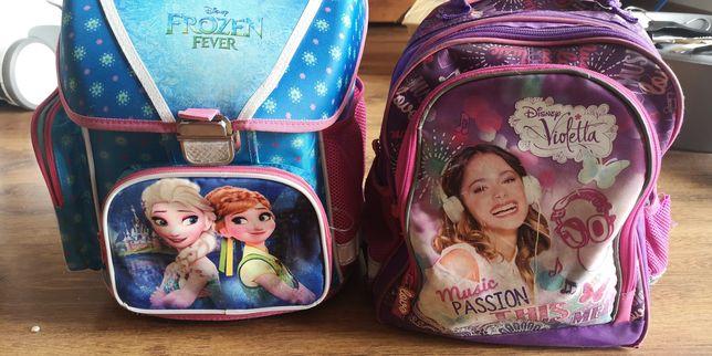 Dwa plecaki Frozen i Violetta stan BDB