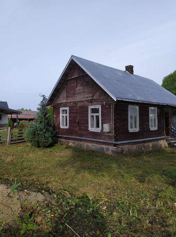 Sprzedam drewniany dom z działką