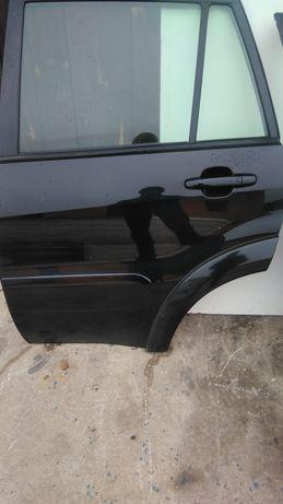 Toyota RAV4 II 2005r fl drzwi lewe lewy tył kod 202  do założenia