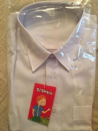 Продам новую белую рубашку с длинным рукавом, рост 140