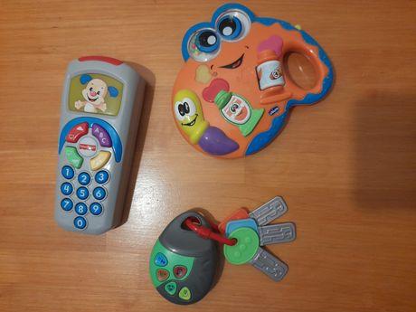 Brinquedos de bebé: telemóvel, chaves e caranguejo