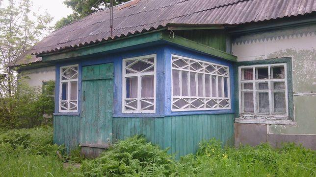 Продається участок з будинком