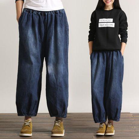 Luźne spodnie jeansowe, szerokie nogawki tzw. 'sindbady'