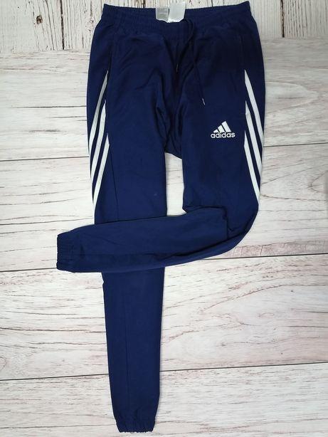 Dresy damskie spodnie dresowe ze ściągaczami granatowe Adidas roz. S