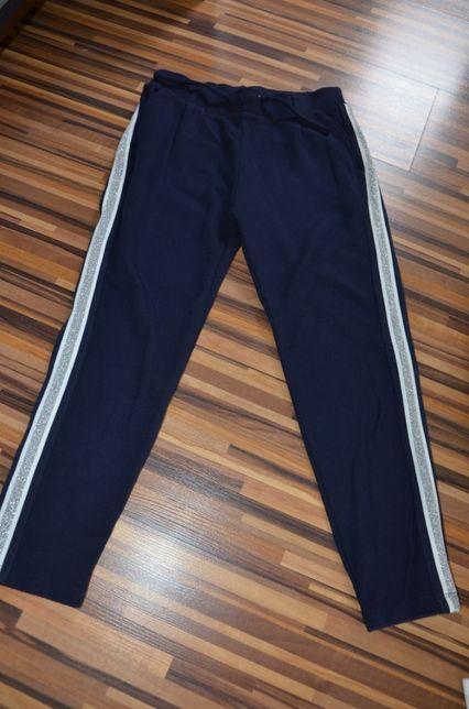 Spodnie dresowo/eleganckie z lamówka Rigga r134/140