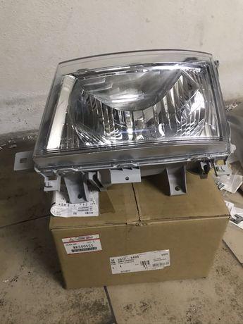 Farol esquerdo fuso/canter Mk580555