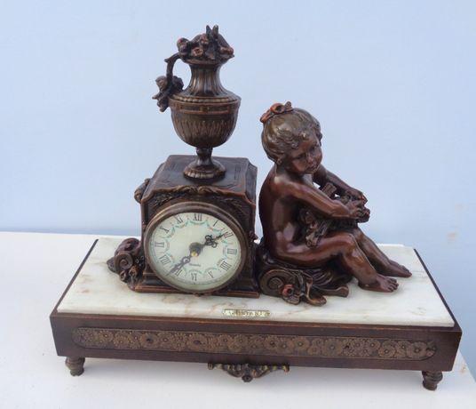Relógio com anjo em marfinite