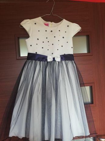 Sprzedam granatową sukienkę dla dziewczynki