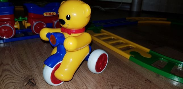 Развивающая игрушка Медвежонок на велосипеде Tolo