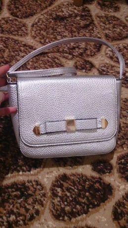 Нова сумка срібного кольору
