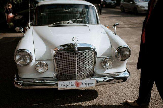 Pojazd do ślubu klasyczna limuzyna ponad 50-letni Mercedes retro