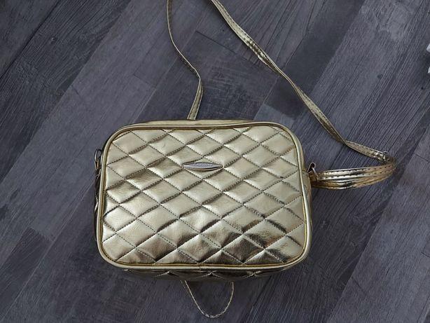 Nowa złota torebka
