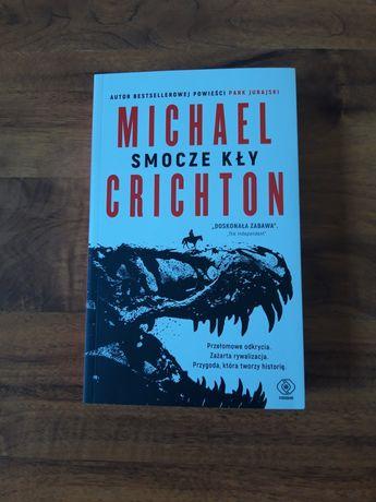 """Książka M. Crichton """"Smocze kły"""""""