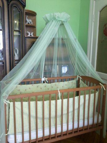 Дитяче ліжечко-гойдалка.