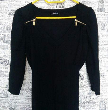 Czarny sweter ze złotymi zamkami i dekoltem V