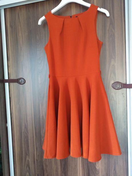 Ruda sukienka piękna . 38 rozmiar stan idealny pięknie w tańcu wygląda