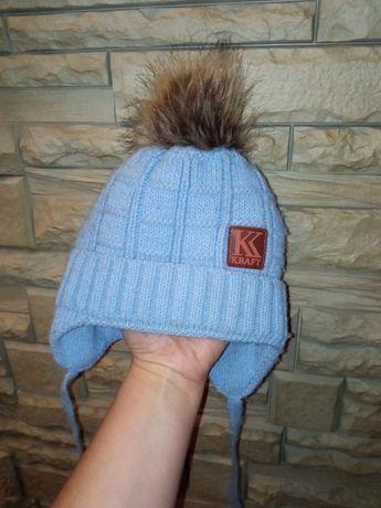 Продам зимнюю детскую шапку