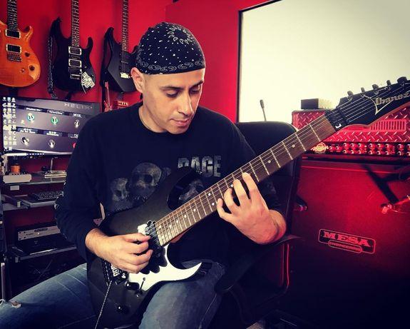 Aulas de guitarra presenciais ou online