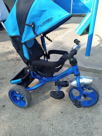 Продам велосипед трех колесный,с ручкой родительской,и с корзиной .