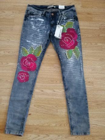 Spodnie rurki kwiaty jeansy