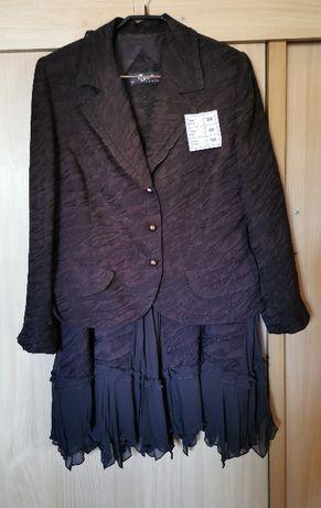 Elegancki dwuczęściowy kostium - żakiet i spódnica.