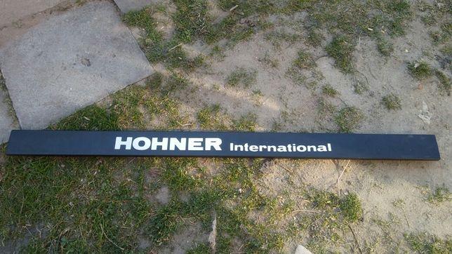 HOHNER International - element stojaka?