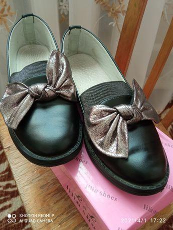 Туфельки на дівчинку