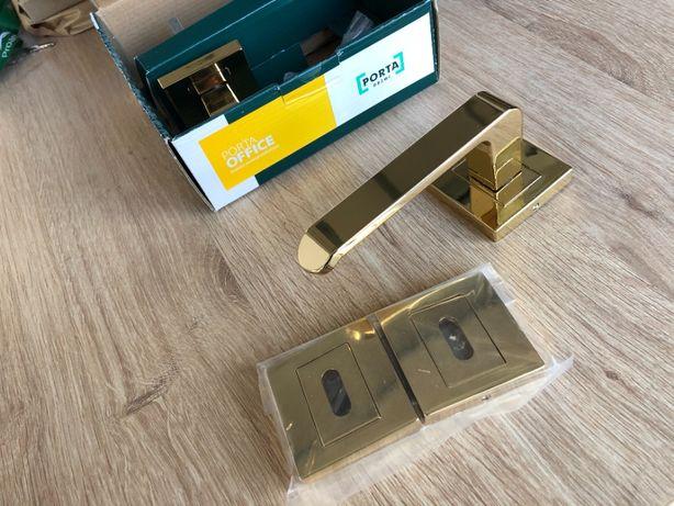 Nowe klamki OFFICE Porta złote 8 sztuk + rozety
