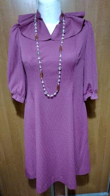 Śliczna dopasowana sukienka z falbaną, 44-46.