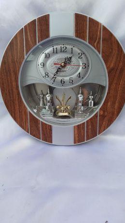 Настенные часы с вертушкой