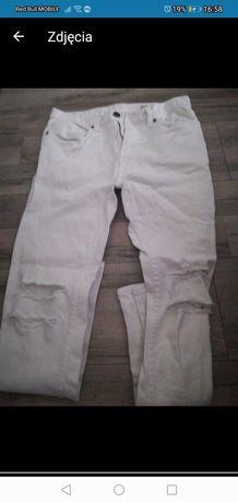 Spodnie z dziurami białe damskie